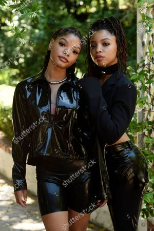 Stock Photo of Halle Bailey, left, and her sister Chloe of the R&B duo Chloe X Halle pose together for a portrait in their backyard, in Los Angeles