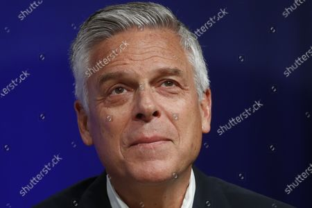 """In this May 20, 2020 photo, Republican Utah gubernatorial candidate and former ambassador Jon Huntsman Jr. looks on during a debate in Salt Lake City. Huntsman says he has tested positive for COVID-19. Huntsman said, he is experiencing """"classic symptoms"""" of the illness caused by the coronavirus, and will isolate himself while his campaign continues"""