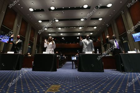 (L to R); Georgetown University Law School professor Paul Butler, Lancaster (California) City Council member Angela Underwood Jacobs, George Floyd's brother Philonise Floyd and civil rights attorney Benjamin Crump are sworn-in to testify during the US House Judiciary Committee hearing on 'Policing Practices and Law Enforcement Accountability', on Capitol Hill in Washington, DC, USA, 10 June 2020. The hearing comes after the death of George Floyd while in the custody of officers of the Minneapolis Police Department and the introduction of the Justice in Policing Act of 2020 in the US House of Representatives.