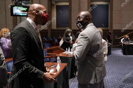 Stock Picture of Paul Butler, law professor at Georgetown University Law Center, elbow bumps Philonise Floyd, brother of George Floyd, after a House Judiciary Committee hearing on proposed changes to police practices and accountability on Capitol Hill, in Washington