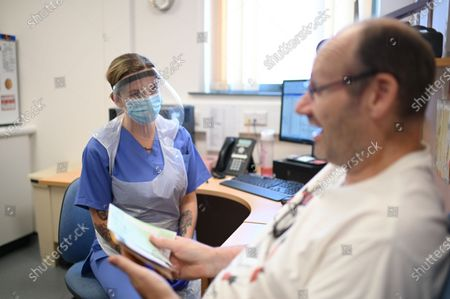 Stock Photo of Nurse Ashleigh Smith (L) wearing personal protective equipment (PPE) speaks with Michael Powell, a patient at the Littlefield practice at Freshney Green Primary Care Centre in Grimsby, Britain, 09 June 2020 (issued 10 June 2020).
