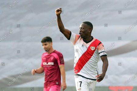 Rayo Vallecano's Luis Advincula (R) celebrates after scoring the 1-0 goal during the Spanish LaLiga SmartBank second division soccer match between Rayo Vallecano and Albacete Balonmpie in Vallecas Stadium, Madrid, Spain, 10 June 2020. It is the first professional soccer match to be plaied in Spain after the lockdown measures implemented in a bid to slow down the spread of the pandemic COVID-19 disease caused by the SARS-CoV-2 coronavirus.
