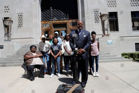 Attorney James Carter, representing the family of Tommie McGlothen, Jr., speaks to media with the family outside the Caddo Parish Courthouse in Shreveport, La., . The family of McGlothen, a black Louisiana man who died in police custody after a videotaped altercation that shows police officers hitting and tasing him demanded answers Wednesday and that the officers be held accountable