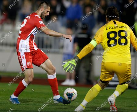 Red Star's Aleksa Vukanovic (L) in action against Partizan's goalkeeper Vladimir Stojkovic (R) during the Serbian Cup semifinal soccer match between Partizan and Red Star in Belgrade, Serbia, 10 June 2020.