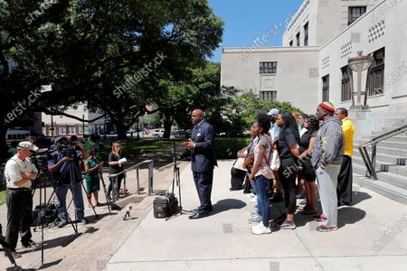 Attorney James Carter, representing the family of Tommie McGlothen, Jr., speaks to media with the family outside the Caddo Parish Courthouse in Shreveport, La., . The family of McGlothen, a black Louisiana man who died in police custody after a videotaped altercation that shows police officers hitting and tasing him Wednesday demanded answers and that the officers be held accountable
