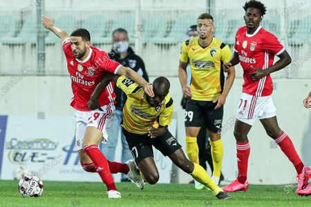 Portimonense's Aylton Boa Morte (2-L) in action against Benfica's Adel Taarabt (L) during the Portuguese First League soccer match between SC Portimonense and Benfica Lisbon in Portimao, Portugal, 10 June 2020.