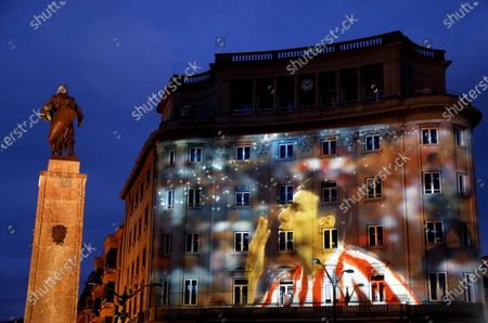 A building is illuminated with a picture of Athletic Bilbao striker Aritz Aduriz to celebrate the resumption of Spanish La Liga soccer matches after the national lockdown in a bid to slow down the spread of the pandemic COVID-19 disease caused by the SARS-CoV-2 coronavirus in Bilbao, Spain, 10 June 2020. Athletic Bilbao will face Atletico Madrid on 14 June 2020.