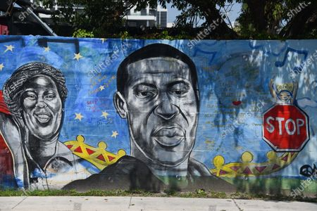George Floyd and Breonna Taylor seen. A mural in Overtown, an area in Miami, honors the faces of the Black Lives Matter Movement. The mural created by Artist Kyle Holbrook, shows the people of the Black Lives Matter movement to include Colin Kaepernick, Breonna Taylor, and George Floyd.  Overtown is historically a black neighborhood in Miami.
