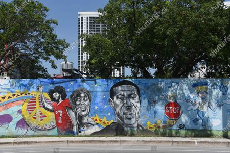 A mural in Overtown, an area in Miami, honors the faces of the Black Lives Matter Movement. The mural created by Artist Kyle Holbrook, shows the people of the Black Lives Matter movement to include Colin Kaepernick, Breonna Taylor, and George Floyd.  Overtown is historically a black neighborhood in Miami.