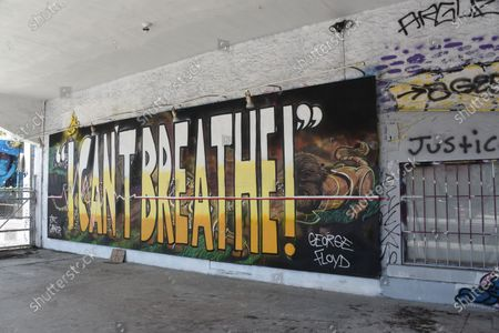 A mural in Miami, honors Eric Garner and George Floyd. Both individuals lost their lives to police brutality and they are part of the Black Lives Matter movement.