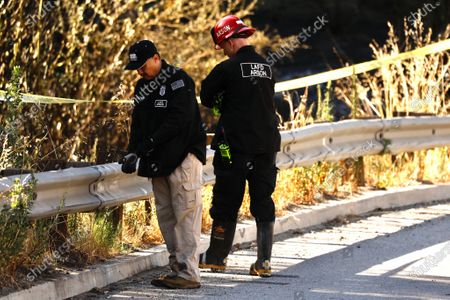 LAFD Arson investigators Joe Sanchez, left, and Robert Williams On a Sepulveda Blvd near Getty Center Drive as they investigate the origin of the Brushfire that broke out after midnight in the Sepulveda Pass threatening homes of Bel Air. Firefighters were able to stop forward movement of the blaze at about 50 acres.