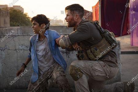 Rudhraksh Jaiswal as Ovi Mahajan and Chris Hemsworth as Tyler Rake