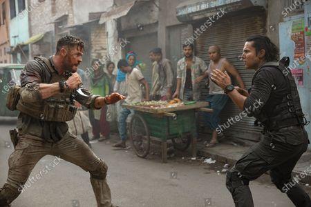 Chris Hemsworth as Tyler Rake and Randeep Hooda as Saju