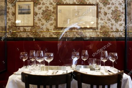 Plastic shields are placed on the table of the Alain Ducasse's restaurant « Allard », in Paris, . French Michelin-starred chef Alain Ducasse unveils virus-protection measures as he prepares to reopen his restaurants, including a new filtration system that works to stop virus particles from the air traveling to neighboring tables