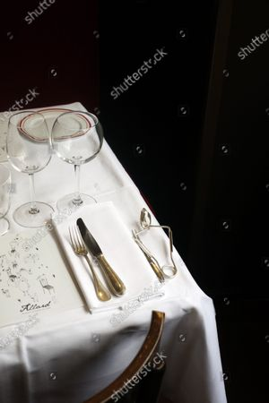 Stock Image of Glasses and cutlery are placed on a table of Alain Ducasse's restaurant « Allard », in Paris, . French Michelin-starred chef Alain Ducasse unveils virus-protection measures as he prepares to reopen his restaurants, including a new filtration system that works to stop virus particles from the air traveling to neighboring tables