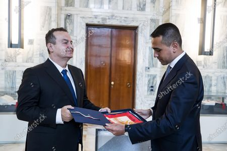 Italian Foreign Minister Luigi Di Maio (R) and Serbian Foreign Minister Ivica Dacic (L), exchange gifts during a meeting at the Farnesina palace in Rome, Italy, 11 June 2020.