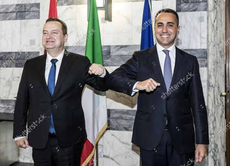 Italian Foreign Minister Luigi Di Maio (R) and Serbian Foreign Minister Ivica Dacic (L), greet with the elbows during a meeting at the Farnesina palace in Rome, Italy, 11 June 2020.
