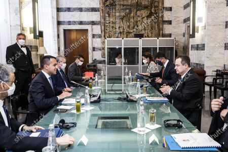 Italian Foreign Minister Luigi Di Maio (2-L) and Serbian Foreign Minister Ivica Dacic (R), during a meeting at the Farnesina palace in Rome, Italy, 11 June 2020.