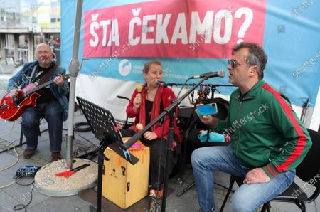 Stock Image of The presidents of the People's and Democratic Party, Vuk Jeremic and Zoran Lutovac, talked to the citizens about the reasons for the boycott of the upcoming elections at Kalenic market.