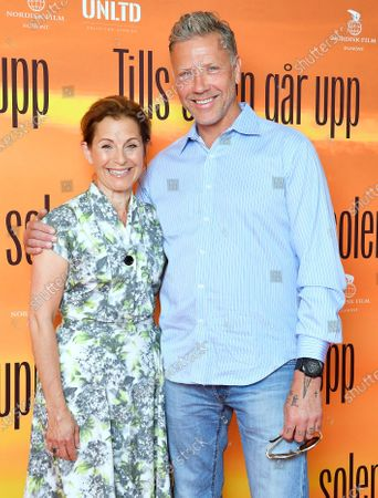 """Stock Image of Swedish actor Mikael Persbrandt with singer/actress Helen Sjöholm at a photo call for the movie """"Tills solen går upp"""" (Until the sun rises)"""