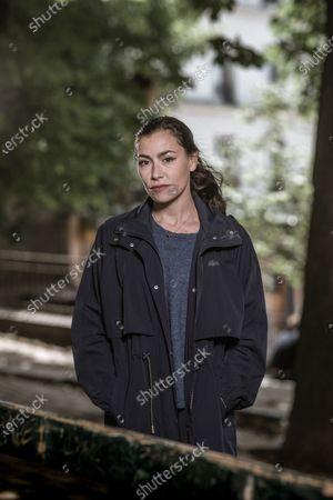Olivia Ruiz poses for a photoshoot in woodland surroundings.