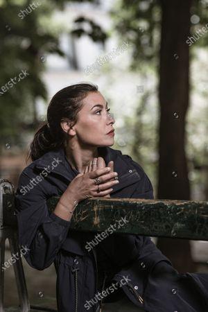 Stock Photo of Olivia Ruiz poses for a photoshoot in woodland surroundings.