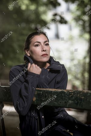 Stock Image of Olivia Ruiz poses for a photoshoot in woodland surroundings.