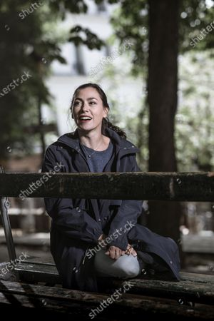 Stock Picture of Olivia Ruiz poses for a photoshoot in woodland surroundings.