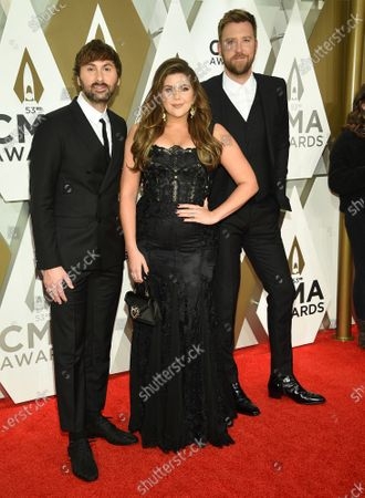 "Dave Haywood, from left, Hillary Scott, and Charles Kelley of Lady Antebellum at the 53rd annual CMA Awards in Nashville, Tenn. The group is changing their name to Lady A, saying they are regretful for not taking into consideration the word's associations with slavery. They said in recent weeks, their eyes have been opened to ""blindspots we didn't even know existed"" and ""the injustices, inequality and biases black women and men have always faced"