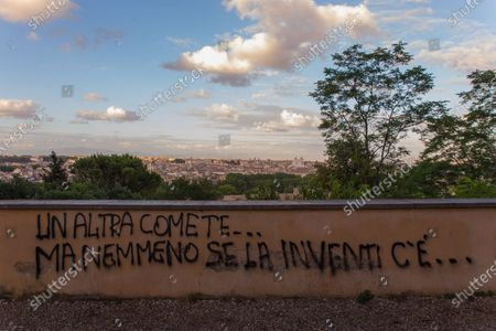 """Phrase taken from the song """"Another you"""" by Italian singer Eros Ramazzotti. Love phrase written on a wall on the Janiculum hill in Rome"""