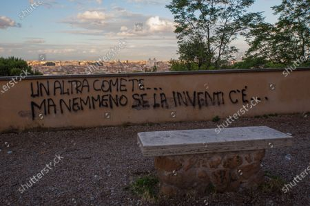 """Stock Image of Phrase taken from the song """"Another you"""" by Italian singer Eros Ramazzotti. Love phrase written on a wall on the Janiculum hill in Rome"""
