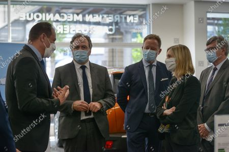 Agnes Pannier-Runacher, State Secretary to the Minister of the Economy, visits with Luc Chatel, president of the Automobile Platform - PFA, and Xavier Horent, general delegate of the National Council of Automobile Professions - CNPA, a PSA Retail Peugeot car dealership in the 15th district of Paris, on the occasion of the consolidation of the conversion bonus, as part of the automobile support plan.