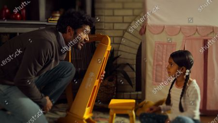 Stock Image of Sendhil Ramamurthy as Mohan Venkatesan and Royal Patel as 6-year-old Devi