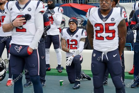 Houston Texans wide receiver Kenny Stills (12) kneels during the national anthem before an NFL football game between the Texans and the Tennessee Titans in Nashville, Tenn. NFL players who want to kneel during the national anthem to protest police brutality and racism have far more support than Colin Kaepernick did four years ago