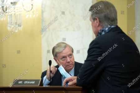 United States Senator Lindsey Graham (Republican of South Carolina) speaks to United States Senator David Perdue (Republican of Georgia) during a United States Senate Committee on the Budget business meeting at the United States Capitol in Washington D.C., U.S.,, as they consider the nomination of Director, Office of Management and Budget (OMB) Russell Vought to be White House Office of Management and Budget.