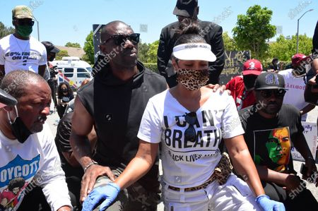 Terrell Owens and LisaRaye McCoy walk in a Black Lives Matter protest through Inglewood