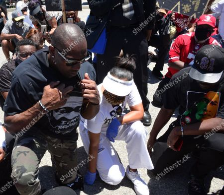 Stock Image of Terrell Owens and LisaRaye McCoy walk in a Black Lives Matter protest through Inglewood