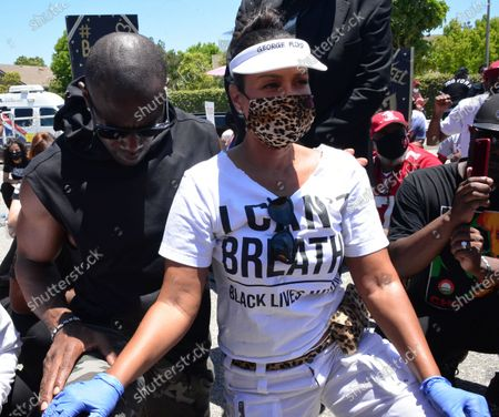 Stock Photo of Terrell Owens and LisaRaye McCoy walk in a Black Lives Matter protest through Inglewood