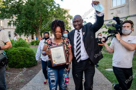 Tamika Palmer (L) and Benjamin Crump leave Metro Hall after the passing of Breonna's Law as protestors gather at the Black Lives Matter Louisville '#NOMORENOKNOCKS' Rally in support of Breonna's Law Thursday June 11, 2020 at Metro Hall in Louisville, Kentucky. A city council meeting regarding Breonna's Law was live-streamed to attendees and resulted in a unanimous vote in favor of banning No Knock Warrants.