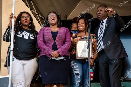 (L-R) Jessica Green, Barbara Sexton Smith, Ju'Niyah Palmer and Tamika Palme stand as Benjamin Crump (R) speaks to the crowd after the passing of Breonna's Law. Protestors gathered at the Black Lives Matter Louisville '#NOMORENOKNOCKS' Rally in support of Breonna's Law Thursday June 11, 2020 at Metro Hall in Louisville, Kentucky. A city council meeting regarding Breonna's Law was live-streamed to attendees and resulted in a unanimous vote in favor of banning No Knock Warrants.