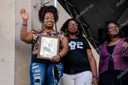 (L-R) Tamika Palmer, Jessica Green and Barbara Sexton Smith look out at the crowd after the passing of Breonna's Law. Protestors gathered at the Black Lives Matter Louisville '#NOMORENOKNOCKS' Rally in support of Breonna's Law Thursday June 11, 2020 at Metro Hall in Louisville, Kentucky. A city council meeting regarding Breonna's Law was live-streamed to attendees and resulted in a unanimous vote in favor of banning No Knock Warrants.