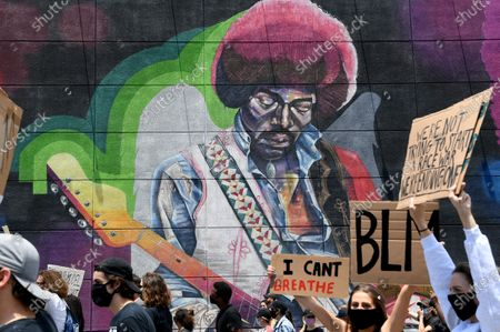 HOLLYWOOD, CALIFORNIA JUNE 6, 2020 - Protestors march past a mural of Jimi Hendrix along Sunset Blvd. in Hollywood Saturday. The protest was organzied by the Refuse Fascism group. (Wally Skalij/Los Angeles Times)
