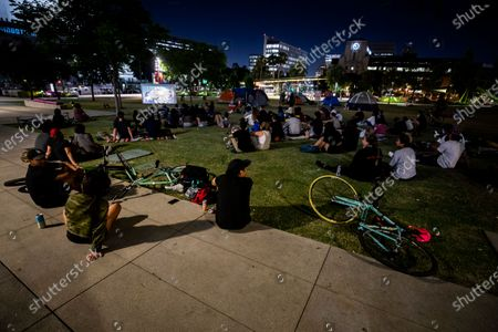 Protesters watch the movie 'Do the Right Thing' by US director Spike Lee next to the tents of Occupy BLM (Black Lives Matter) during the continued demonstrations over the arrest and death of George Floyd, at City Hall in Los Angeles, California, USA, 11 June 2020. A bystander's video, which was posted online on 25 May, appeared to show George Floyd pleading with arresting officers that he couldn't breathe as an officer knelt on his neck. The unarmed black man later died in police custody.