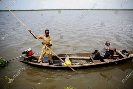 A Nigerian man moves a pirogue with captured live Alligators onboard after wildlife hunting as he arrives on the shore of the Lagos Lagoon near a wet market, Nigeria, 09 June 2020 (issued 12 June 2020). For centuries across West Africa wildlife has been traded for food in the culturally accepted business of bushmeat sales. For many families in rural areas this old tradition of hunting and selling bushmeat is their single means of income. The World Animal Protection is calling for a stop on all wildlife trade. The charity is driving a campaign to support a global trade ban for wildlife at the G20 meeting of world leaders in November to protect wildlife and help prevent future zoonotic pandemics. According to World Animal Protection wild animals captured from their natural habitat or bred in captivity are typically placed in cramped cages and unhygenic conditions causing suffering and creating a lethal hotbed of disease. This can harm humans when coming into contact with them as occurred with Covid-19.
