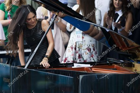 The pianist Lola Astanova performs at the end of the exhibition double match
