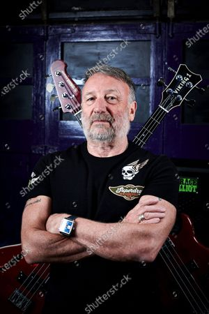 Portrait of English musician Peter Hook, photographed at his rehearsal studio in Cheshire, England. Hook is best known as a bassist with influential rock groups Joy Division and New Order, and also as the bassist and vocalist with Peter Hook And The Light.