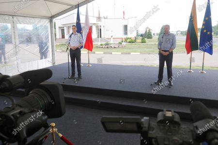 Polish Prime Minister Mateusz Morawiecki (L) and Lithuanian Prime Minister Saulius Skvernelis (R) during a meeting at the Budzisko-Kalvarija border crossing in the Podlasie Voivodeship, Poland, 12 June 2020. On the night of 12-13 June, Poland will restore full border traffic within the internal borders of the European Union. The EU's external borders will remain closed.