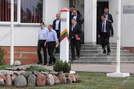 Polish Prime Minister Mateusz Morawiecki (C-L) and Prime Minister of the Republic of Lithuania Saulius Skvernelis (C-R) during a meeting at the Budzisko-Kalvarija border crossing in the Podlasie Voivodeship, Poland, 12 June 2020. On the night of 12-13 June, Poland will restore full border traffic within the internal borders of the European Union. The EU's external borders will remain closed.