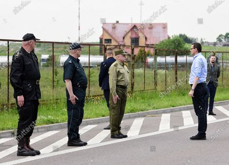 Polish Prime Minister Mateusz Morawiecki (2R) during a meeting with the Prime Minister of the Republic of Lithuania Saulius Skvernelis at the Budzisko-Kalvarija border crossing in Podlaskie Voivodeship, Poland, 12 June 2020. On the night of 12-13 June, Poland will restore full border traffic within the internal borders of the European Union. The EU's external borders will remain closed.