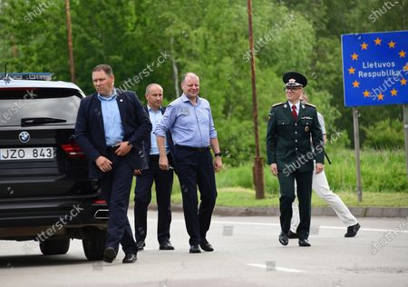Lithuanian Prime Minister Saulius Skvernelis (C) on his way to a press conference with the participation of the Polish Prime Minister Mateusz Morawiecki at the Budzisko-Kalvarija border crossing in Podlaskie Voivodeship, Poland, 12 June 2020. On the night of 12-13 June, Poland will restore full border traffic within the internal borders of the European Union. The EU's external borders will remain closed.